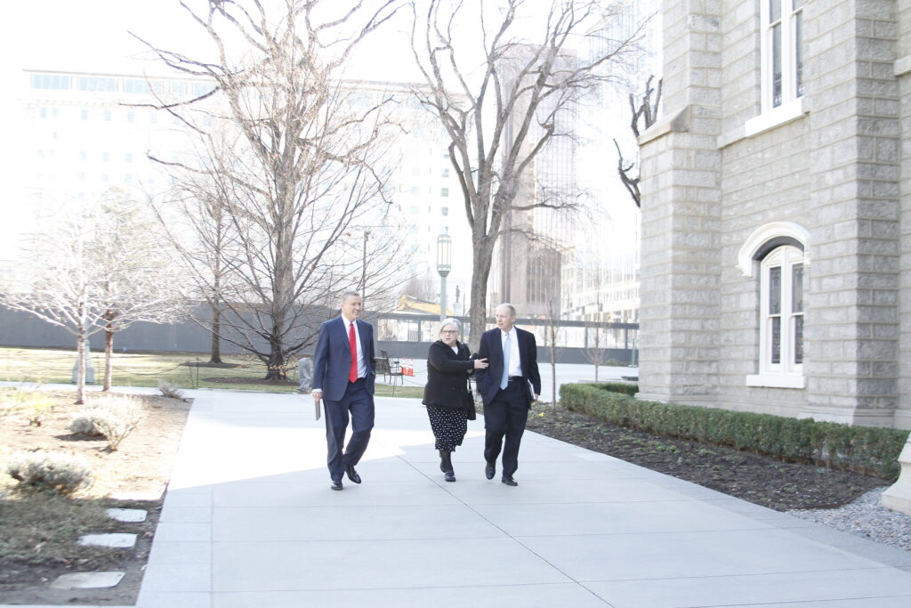 Elder Kevin R. Duncan, left, walks to the Assembly Hall LDS Business College with President Bruce R. Kusch and his wife, Sister Alynda Kusch, for a devotional on March 10, 2020.