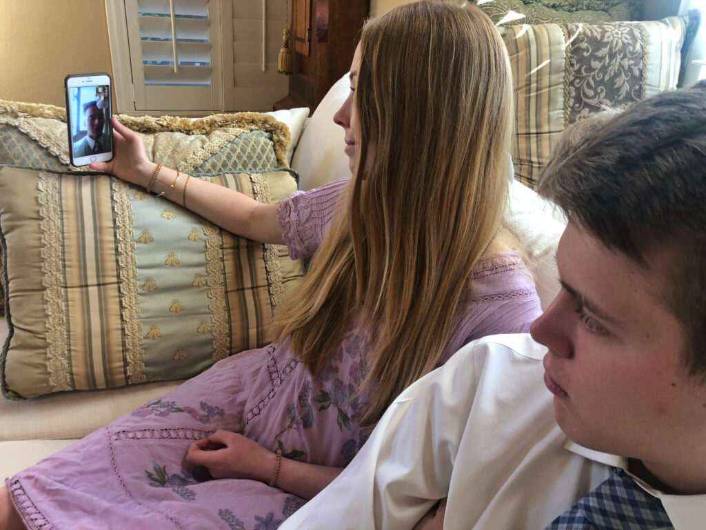 Lauren Bell enjoys a video phone call with her missionary brother, Elder Joe Bell, during the family's March 15, 2020, home-based Sabbath day meeting. Church leaders have put traditional Sunday meetings on hold during the coronavirus pandemic.