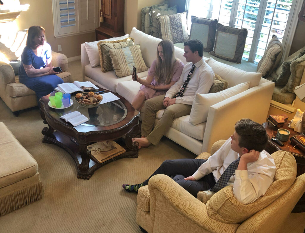 The Bells enjoy a home-based Sabbath day meeting in their San Clemente, California, home on March 15, 2020.