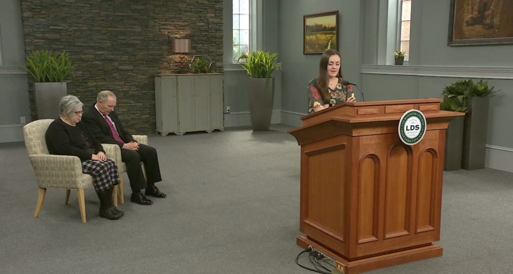 An LDS Business College student offers a prayer during a livestream devotional featuring President Bruce C. Kusch on Tuesday, March 17. The devotional was livestreamed because of the ongoing COVID-19 pandemic.