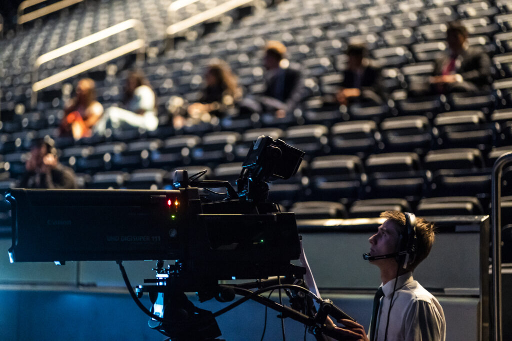 A cameraman films a devotional broadcast from BYU's Marriott Center in Provo, Utah, on March 17, 2020.