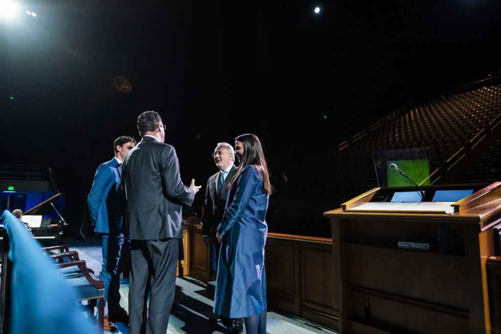 Elder Jack N. Gerard and his wife, Sister Claudette Neff Gerard, right, speak with Matthew Richardson, academic vice president of BYU, following a devotional broadcast from a nearly empty Marriott Center in Provo, Utah, on March 17, 2020.