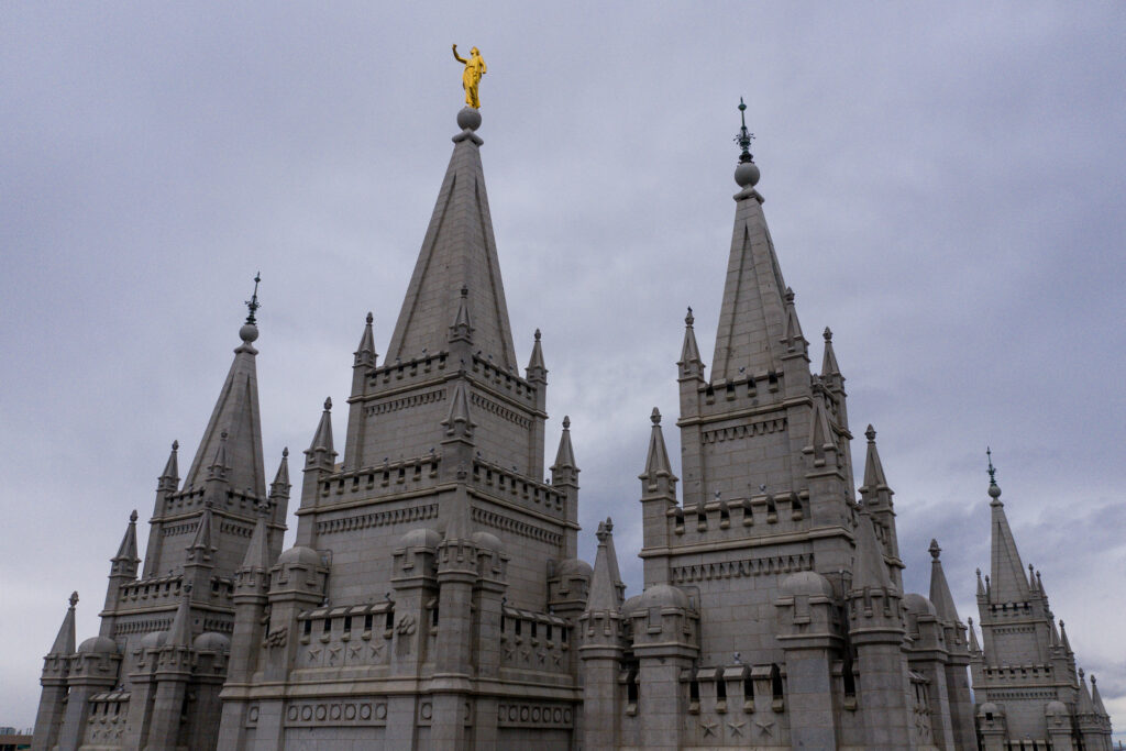 The Angel Moroni statue atop the Salt Lake Temple of The Church of Jesus Christ of Latter-day Saints stands with its trumpet missing after an earthquake in Salt Lake City on Wednesday, March 18, 2020.