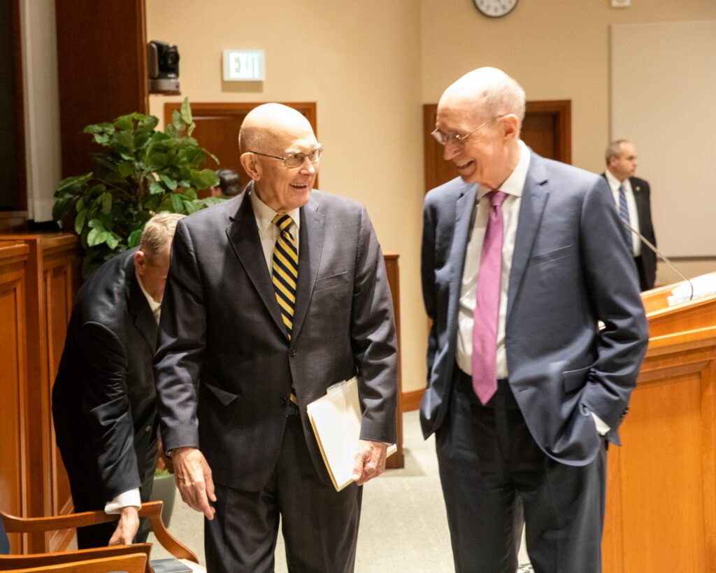 President Dallin H. Oaks shares a laugh with President Henry B. Eyring on March 13, 2020, at the Brigham Young University Church History Symposium in the Church Office Building Auditorium in Salt Lake City.