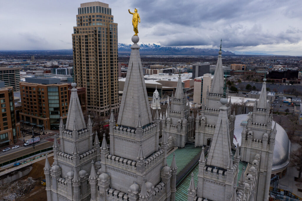 The Angel Moroni statue atop the Salt Lake Temple of The Church of Jesus Christ of Latter-day Saints stands with its trumpet missing after a 5.7 magnitudeearthquake centered in Magna hit on Wednesday, March 18, 2020.
