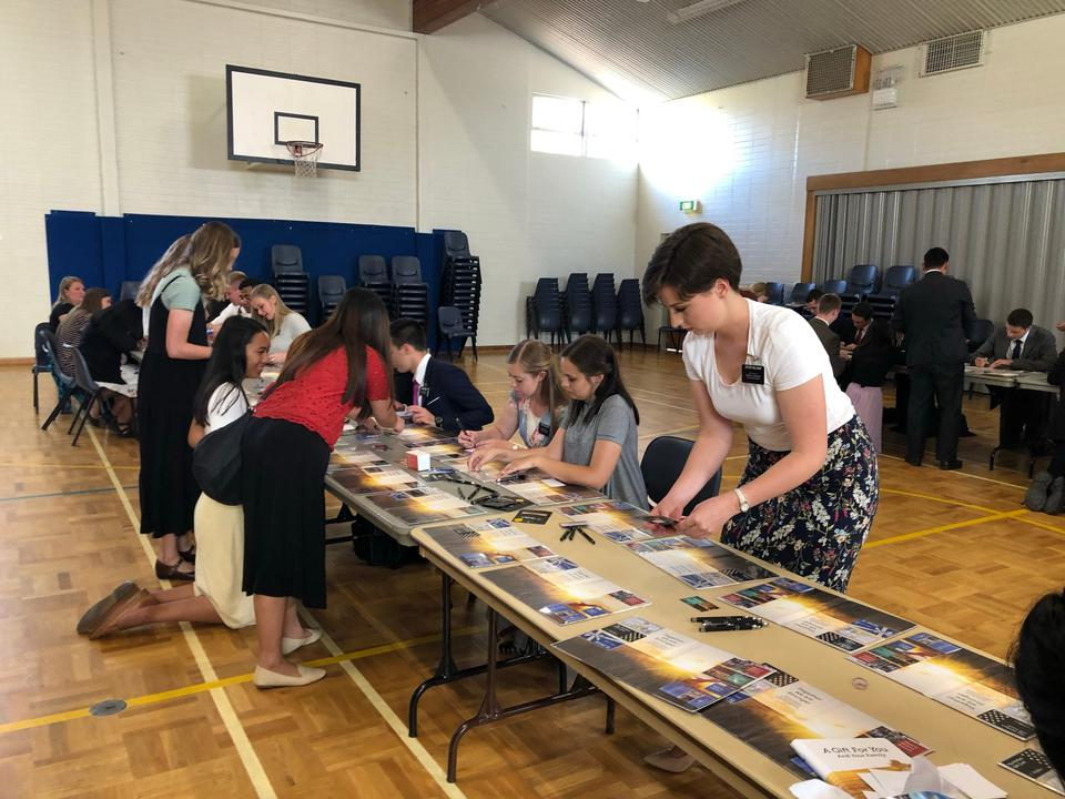 Missionaries in Adelaide, Australia assemble gift wallets for Kangaroo Island families on March 13, 2020.