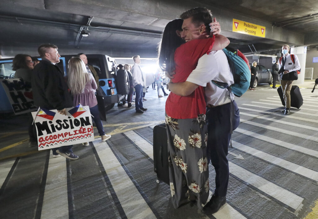 Elder James Young is hugged by his mother, April Young, as hundreds of missionaries from The Church of Jesus Christ of Latter-day Saints return from the Philippines to Salt Lake City International Airport on Sunday, March 22, 2020.