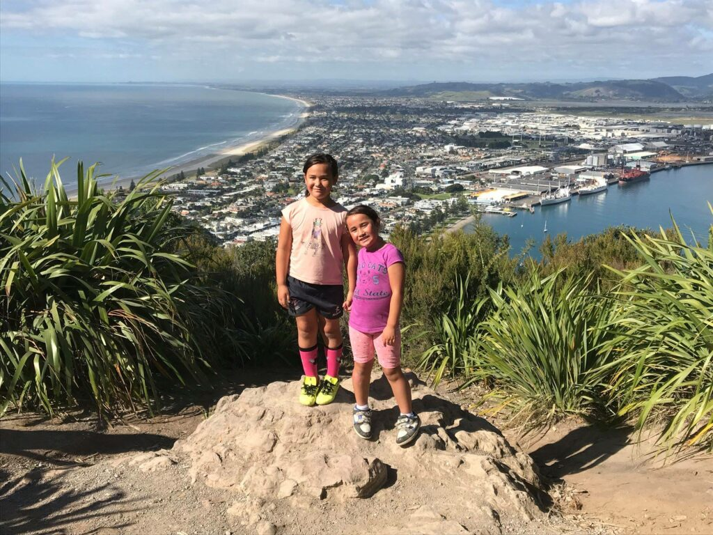 Ma'a Finau's daughters, Olivia and Emily, are pictured on Mount Maunganui near Tauranga, New Zealand. Finau said one of the blessings he has seen during the coronavirus outbreak is spending more time with his family.