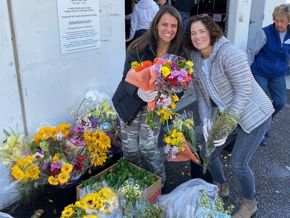 A pair of Relief Society sisters organize floral arrangements to be distributed to people in need through the Family Assistance Ministries in Orange County, California.