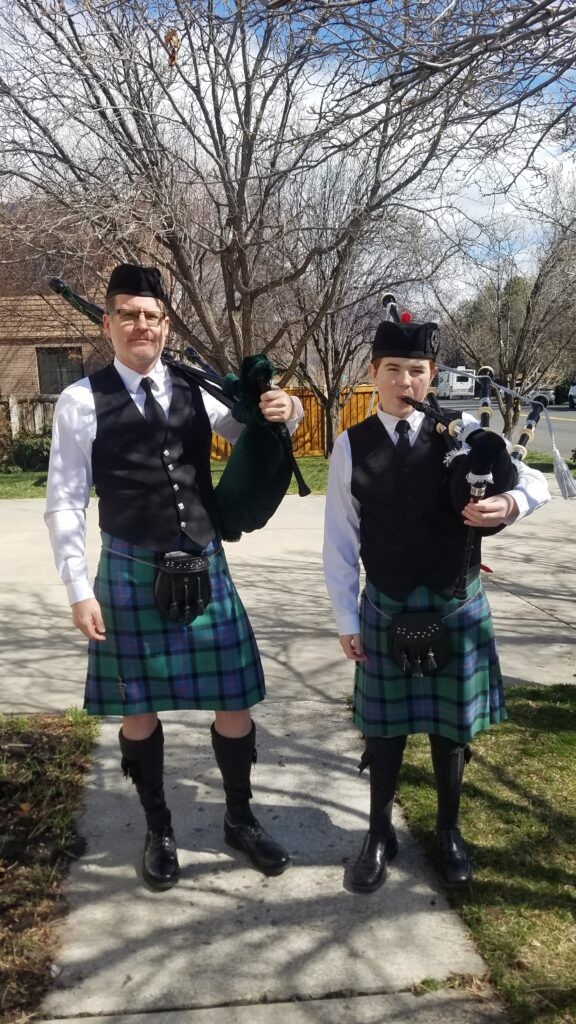 Emily Maughan's husband, Matthew, and son, Willem, play the bagpipes for the neighborhood on Sunday, March 22, 2020.